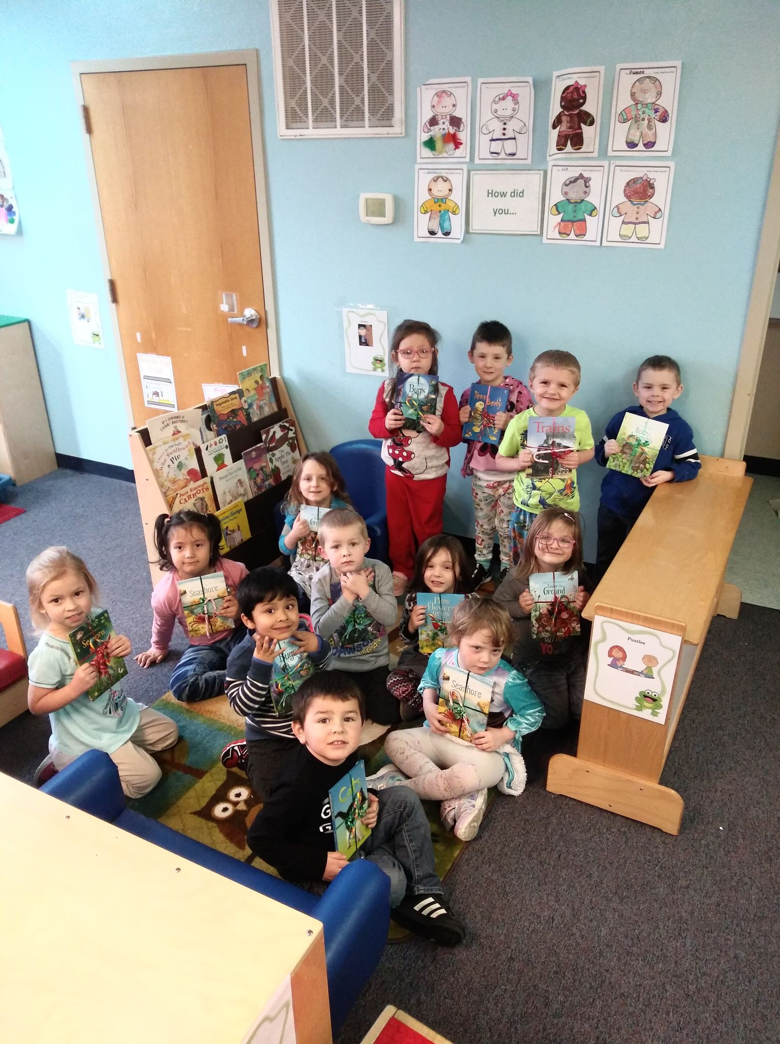 Students in Reedsburg Headstart Programs pose with some of the new books given by Usborne Books & More. (Submitted photos)