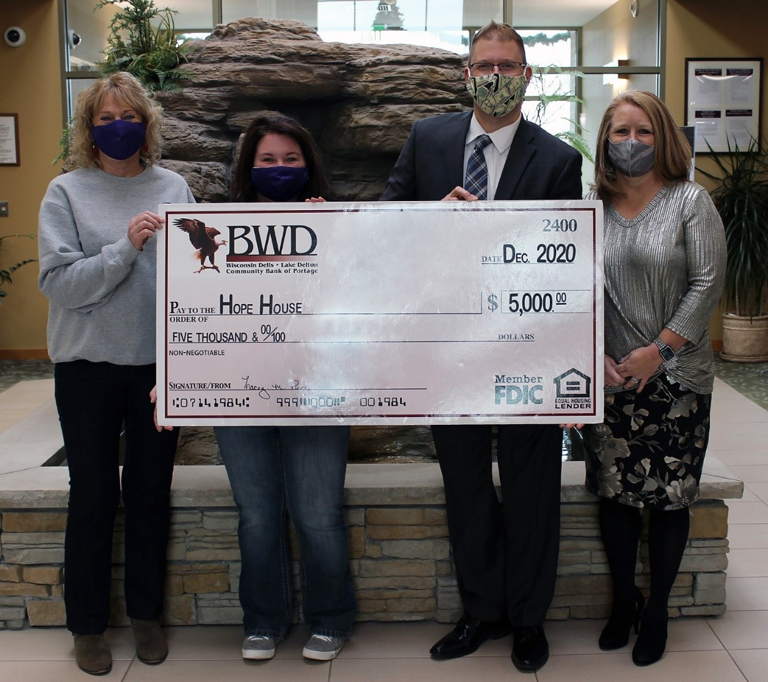 Bank of Wisconsin Dells gave $5,000 to Hope House of South Central Wisconsin in December. Seen here, from left, are Deb Bauer, Annabelle Lange, Scott Rockwell and Tammy Maki. The money went toward supporting families in need during the holidays. Due to the pandemic, Hope House received more requests than usual for aid. (Submitted photo)