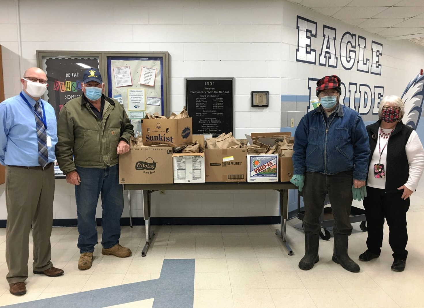 The Cazenovia American Legion once again assembled goodie bags for all Weston Elementary School students during the 2020 holidays. Normally Santa delivers these bags but his helpers did so instead due to COVID-19. Seen here are, from left, Elementary Principal Jason Meyer, Legion representatives Jim Deitelhoff and Wayne Morse and Weston Community Outreach Coordinator Sue Louis. (Submitted photo)