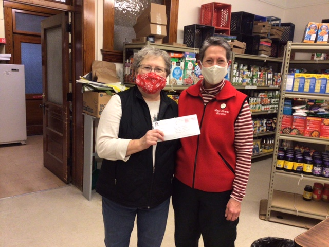 Dana Westedt, owner of Main Street Books, stands with Sandy Hein, a Reedsburg Area Food Pantry volunteer. This past fall, Main Street Books held its annual bargain book sale, where it raised more than $1,000 for the pantry. As part of the effort, Westedt applied for and won a $500 Recharge Grant from the Reedsburg Utility Commission. (Submitted photo)