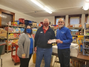 Beth Walz and Blaine Albert of Lorraine's US Cellular present a $650 check to the Reedsburg Area Food Pantry's Dan Rodwell. US Cellular customers traded in used cell phones in November with the choice of applying up to the full value of the phone to the Food Pantry. (Submitted photo)