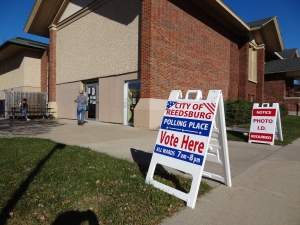 Signs direct people at the entrance of voting at Reedsburg City Hall on Nov. 3. (Photo by Heather Stanek)