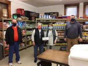 2021 marks the 70th anniversary of the Reedsburg Lions and the club kicked off the year by donating to the Reedsburg Area Food Pantry. Pictured are Mike Gargano, far left, and Phil Peterson, far right, of the Lions Club, presenting a check for $5,000 to Sandy Hein, left, and Shirley Henry of the Pantry. In 2020, the club donated $16,000 overall to the pantry. The Lions Club is committed to supporting scholarships, youth sports, eye screening, the new high school athletic facility, the Boys and Girls Club an