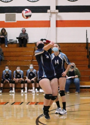 Abbie Spencer, No. 5, bumps the ball for Weston while Saige Allbaugh, No. 14, looks on during last Thursday's volleyball game at Weston.