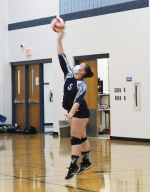 Abbie Spencer sends the ball across the net on this serve effort for the Weston volleyball team vs. DeSoto last week at Weston High School. Weston notched its second dual match win of the season, winning 3-1. (Photo by Troy Matz)