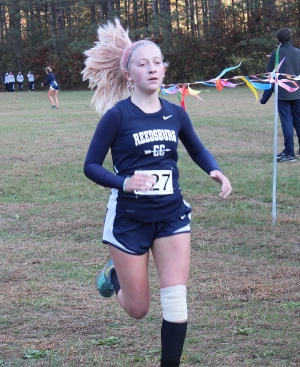Sophomore Abby Voigt crosses the finish line strong for the Reedsburg Beaver girls cross country team at Thursday's Badger North Culmination Meet at the Hartje Center. Baraboo, Sauk-Prairie, Portage and Beaver Dam joined Reedsburg in the five-team event that wraps up the regular season. (Photo by Troy Matz)