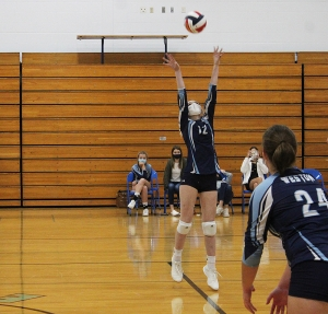 Senior Alissa Laage (#12) sets up a teammate for a spike attempt at the net for the Weston volleyball team in its home opener vs. LaFarge last week at Weston High School. Weston led the match 2-0 but lost the next three sets and the match to the Wildcats. (Photo by Troy Matz)