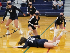 Three Beaver volleyball players, Mahra Wieman (No. 10), McKenna Oetzman (No. 8) and Delaney Horkan (No. 1) all get to the floor to keep the ball alive during this volley vs. Edgewood last week in action at RAHS. Edgewood won the match 3-1 as Reedsburg suffered its first dual match loss of the season. (Photo by Troy Matz)