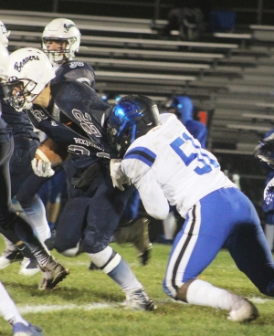 Running back Zach Bestor (No. 22) has his jersey pulled during this running play for the Beaver football team Friday night vs. Watertown. Bestor ran for 35 yards and a touchdown in Reedsburg's 14-9 victory at Millennium Field. (Photo by Troy Matz)