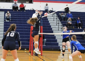 Junior McKenzie Bestor (No. 3) and Macie Wieman team up for a successful block for the Beaver volleyball team in a match vs. Lake Mills last week at RAHS. Bestor had two blocks to help Reedsburg to a 3-1 match win over the visitors. (Photo by Troy Matz)