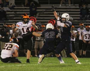 Senior Zach Bestor (No. 22) breaks through to block this Portage FG attempt in the second half for the Beaver football team in the season opener Friday night at Millennium Field. Bestor and the Beavers lost in OT, 13-7. (Photo by Troy Matz)